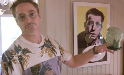 Роберт Дауни-младший возле портрета
